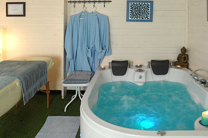 Wellness Oasis with Jacuzzi and Massage Services